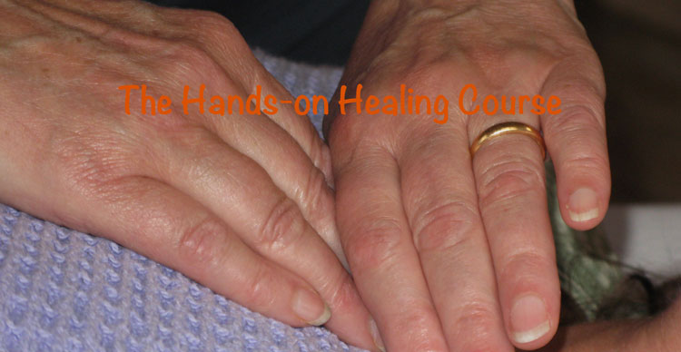 image of hands giving reiki treatment